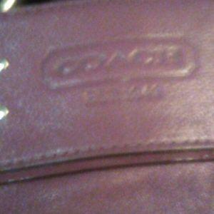 Adorable purple coach purse
